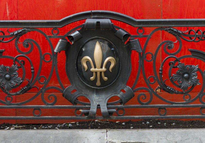 Fleur de lis icon on iron balcony railing in Old Montreal